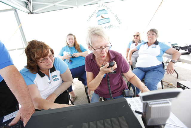 "Rosemary ""Rusty"" Kalkofen attempts to make contact while using HAM radio as Sisterhood of Amateur Radio group members, from left, Lydia Reed, Ann Perrotti, Judy Carpenter and Mary Meiner ..."