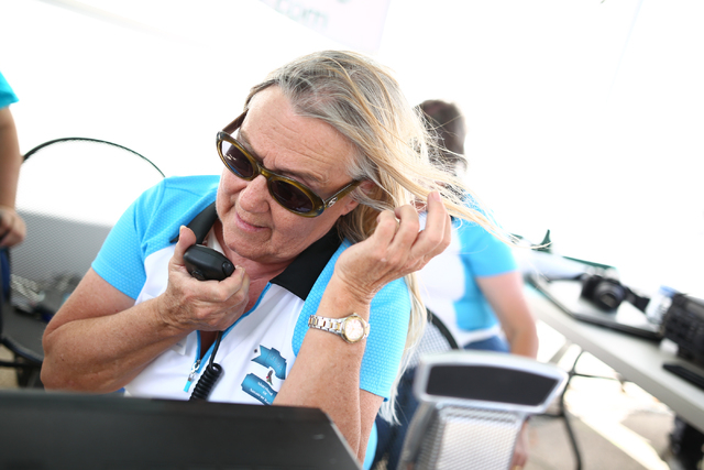 Sisterhood of Amateur Radio member Judy Carpenter attempts to make contact while using HAM radio as the group holds a 12-hour event to make contacts outside of Amateur Electronic Supply, 4640  Pol ...