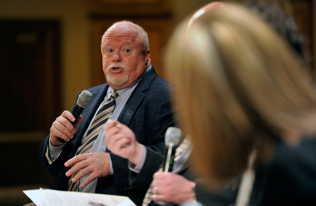 Dan Hart, left, political consultant advising the Nevada State Education Association, speaks during the monthly Hashtags & Headline luncheon at the Texas Station on Monday, May 19, 2014. (David Be ...