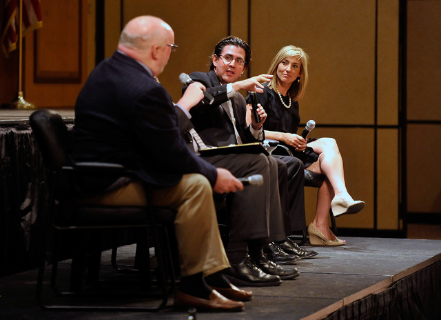 Jeremy Aguero, center, principal analyst with Applied Analysis, speaks between Dan Hart, left, political consultant advising the Nevada State Education Association and Karen Griffin, spokesperson  ...