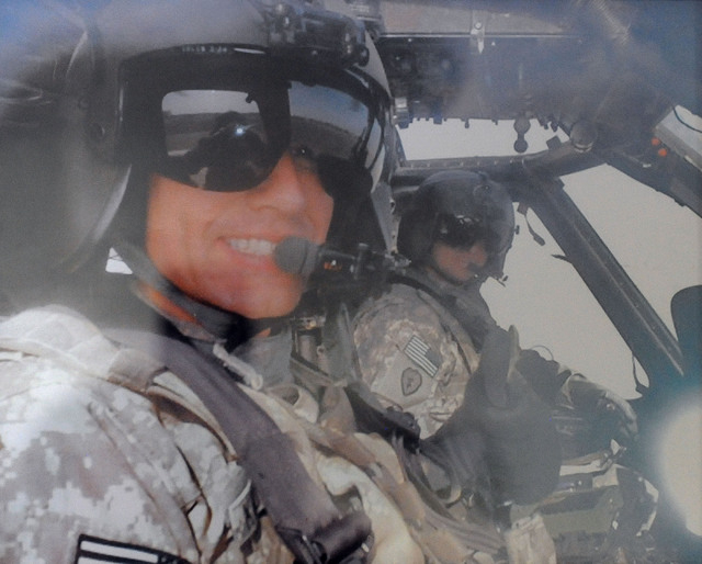 This is a photo of Kathleen Keutmann's son Jon, left, seen at her home in Henderson, Monday, April 28, 2014. Although the photo shows Jon in Afghanistan, he is serving currently at Ft. Campbell, K ...