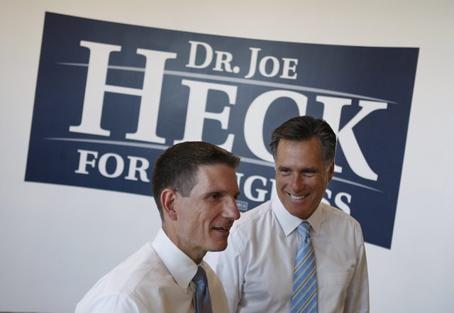 U.S. Rep. Joe Heck, left, is joined by former presidential candidate Mitt Romney during the opening of Heck's campaign headquarters in May 2010 in Las Vegas. Romney again is helping Heck raise m ...