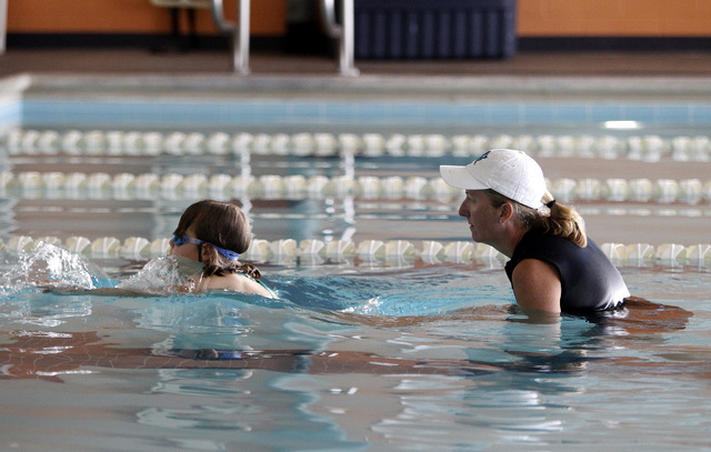 Gail Robinson, right, works with Raegan Walker, 6, during Walker's swim lesson at the Henderson Multigenerational Center in Henderson on Monday, May 5, 2014. The Henderson City Council is discussi ...