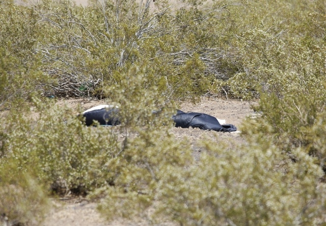 Henderson police and authorities investigate a body that was found near Boulder Highway and Warm Springs Road in Henderson, Nev. Wednesday, May 7, 2014. (John Locher/Las Vegas Review-Journal)