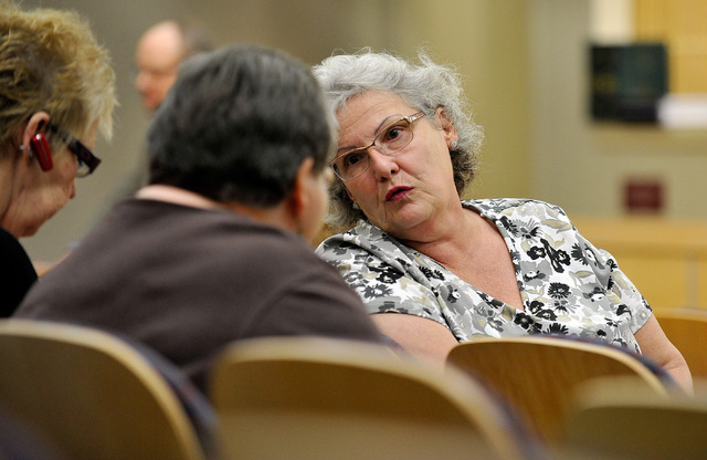 LeaAnne Kelley, right, speaks with others in the audience about potential cuts to the budget and service cuts during the Henderson City Council meeting at the Henderson City Hall on Tuesday, May 6 ...
