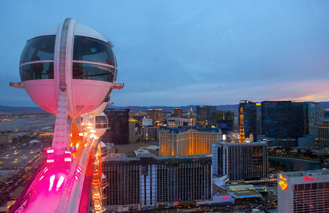 A view of the Las Vegas Strip as seen Friday, April 4, 2014 from the High Roll observation wheel. Caesars Entertainment Corp. grew its net loss nearly 78 percent in the first quarter of 2014 (Jeff ...