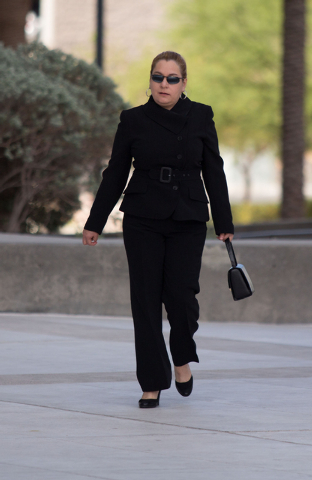 Maria Limon walks into Lloyd George Federal Courthouse Thursday, May 22, 2014. Limon and two other defendants pleaded guilty to one felony count of conspiracy to commit wire and mail fraud in a hi ...