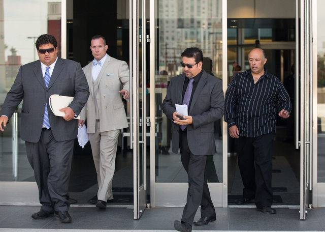 Brothers Rudolfo Alvarez-Rodriguez, third from left, and Jose Luis Alvarez, far right, leave Lloyd George Federal Courthouse Thursday, May 22, 2014. (Samantha Clemens-Kerbs/Las Vegas Review-Journal)