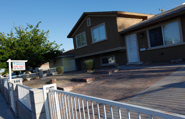 A for sale sign is seen at a home on Parsifal Place near Wallace Drive in the 89107 zip code of Las Vegas on Wednesday, April 30, 2014. Home values in 89107 increased 53.2% in 2013. (Chase Stevens ...