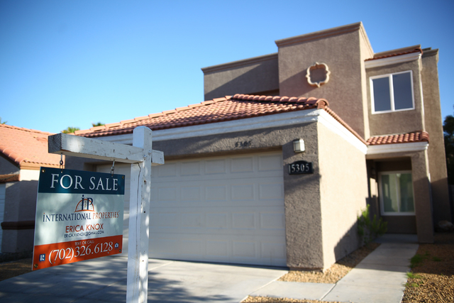 A for sale sign is seen at a home on Harmony Avenue near Michael Way in the 89107 zip code of Las Vegas on Wednesday, April 30, 2014. Home values in 89107 increased 53.2% in 2013. (Chase Stevens/L ...