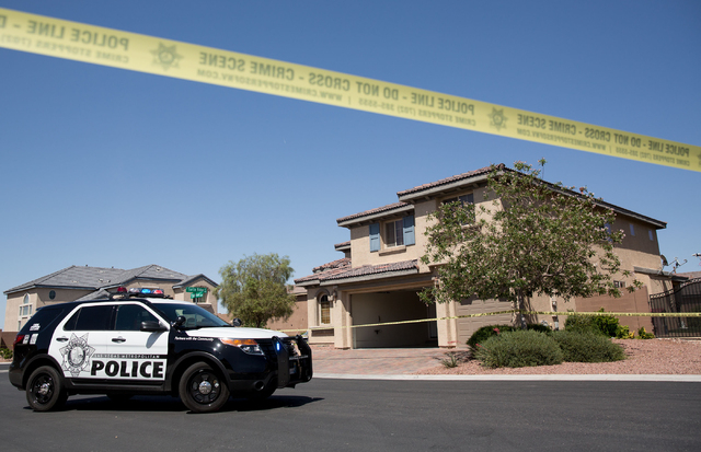 A home at the intersection of Ethan Brook Street and Turtle Ridge Avenue is photographed Monday, May 12, 2014. Police found a person wounded by a gunshot and suspect it could be linked to a home i ...