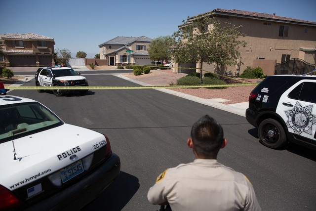 Homes are blocked by police tape in a neighborhood near Las Vegas Boulevard and Starr Avenue on Monday, May 12, 2014. Police found a person wounded by a gunshot and suspect it could be linked to a ...