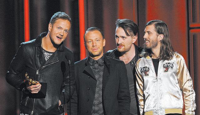 Imagine Dragons members, from left, Dan Reynolds, Ben McKee, Daniel Platzman and Wayne Sermon accept the award for top rock album Sunday at the Billboard Music Awards at the MGM Grand Garden. The  ...