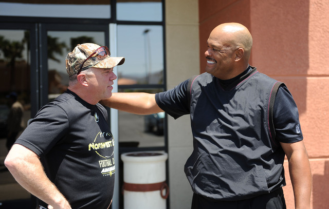 Former UNLV wide receiver Jim Sandusky, left, and quarterback Sam King chat outside a Henderson restaurant, reliving the Rebels' greatest football win ever in 1981 over BYU. (Jerry Henkel/Las Ve ...