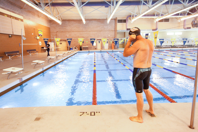 Las Vegas Masters swim team member Joe Wyson puts on his swimming cap before jumping into the pool during a meeting at Desert Breeze Aquatic Facility, 8275 Spring Mountain Rd., in Las Vegas on Thu ...