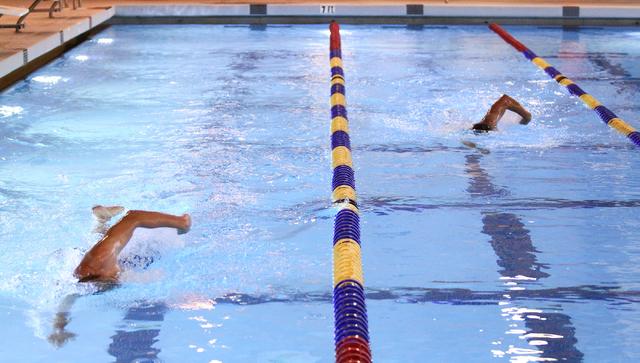 Las Vegas Masters swim team members Dan Wegner, left, and Joe Wyson, swim during a meeting at Desert Breeze Aquatic Facility, 8275 Spring Mountain Rd., in Las Vegas on Thursday, May 8, 2014. The t ...