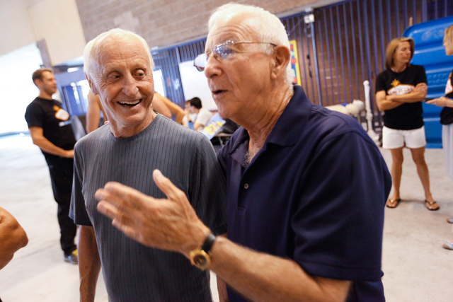 Las Vegas Masters swim team coach Victor Hecker, right, talks with 79-year-old team member Will Arusch during a meeting at Desert Breeze Aquatic Facility, 8275 Spring Mountain Rd., in Las Vegas on ...