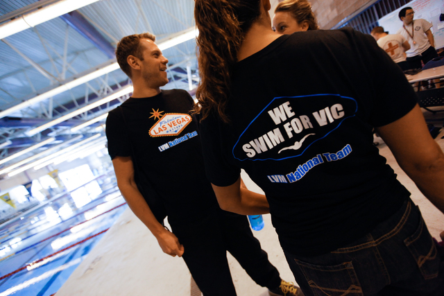 Las Vegas Masters swim team members, from left, Billy Gaines, Melissa Giovanni and Katy Phifer, talk while wearing t-shirts with their team logo during a meeting at Desert Breeze Aquatic Facility, ...