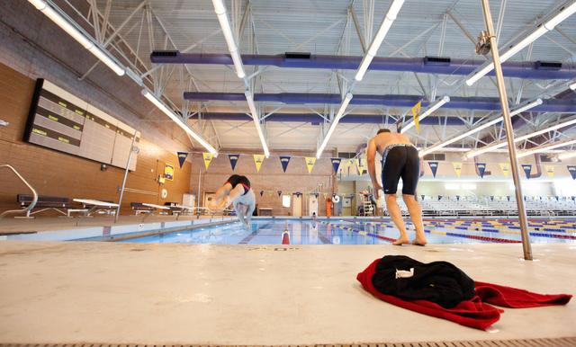 Las Vegas Masters swim team members Dan Wegner, left, and Joe Wyson, jump into the pool during a meeting at Desert Breeze Aquatic Facility, 8275 Spring Mountain Rd., in Las Vegas on Thursday, May  ...