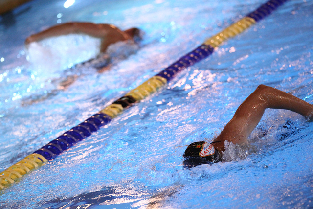 Las Vegas Masters swim team members Joe Wyson, right, and Dan Wegner swim during a meeting at Desert Breeze Aquatic Facility, 8275 Spring Mountain Rd., in Las Vegas on Thursday, May 8, 2014. The t ...