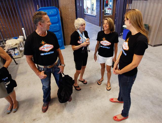Las Vegas Masters swim team members, from left, Joe Wyson, Beverly Meteyer, Carolyn Battin, and Karin Wegner, talk during a meeting at Desert Breeze Aquatic Facility, 8275 Spring Mountain Rd., in  ...