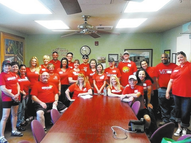 Nearly 50 of Keller Williams Realty of Southern Nevada's real estate agency's employees landscaped, painted and organized at the Shade Tree in time for Mother's Day. The volunteer efforts were par ...
