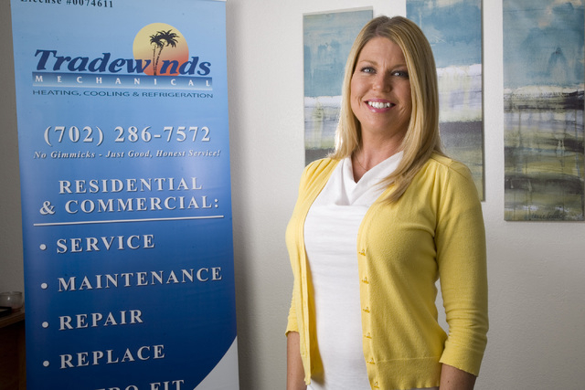 Kirsten Castellanos, owner of Tradewinds Mechanical LLC, a heating, ventilation and air conditioning business, is pictured in her office at 6165 Harrison Drive on April 23. (Jeferson Applegate/Las ...