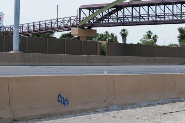 Graffiti is seen sprayed on the outside of a barrier near the newly completed pedestrian bridge over Losee Road and Interstate 15, between Craig Road and Cheyenne Avenue, in North Las Vegas on Sat ...