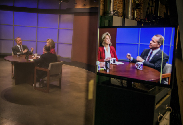 State Sen. Mark Hutchison, R-Las Vegas, right, and former state Sen. Sue Lowden take part in the Republican lieutenant governor debate at KSNV, Channel 3 studios on Monday, May 12, 2014. The Nevad ...