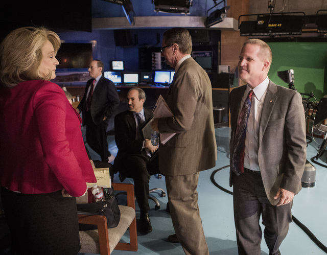 Former state Sen. Sue Lowden, left, and State Sen. Mark Hutchison, R-Las Vegas, leave after the Republican lieutenant governor debate at  KSNV, Channel 3 studios on Monday, May 12, 2014. The debat ...