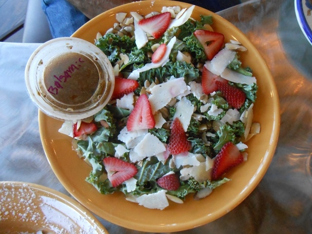 The kale salad at Lulu's Bread and Breakfast, 6720 Sky Pointe Drive, includes sunflower seeds, almonds, shaved romano cheese and a balsamic vinaigrette. (Jan Hogan/View)