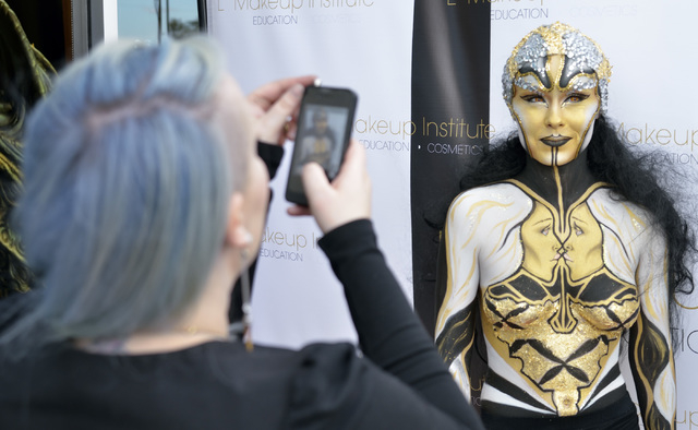 Jasmine Ringo, left, takes a picture of her sister Kassidy Ringo during a grand opening at the L Makeup Institute at 5525 S. Decatur Blvd. in Las Vegas on Wednesday, May 21, 2014. Jasmine is a bea ...