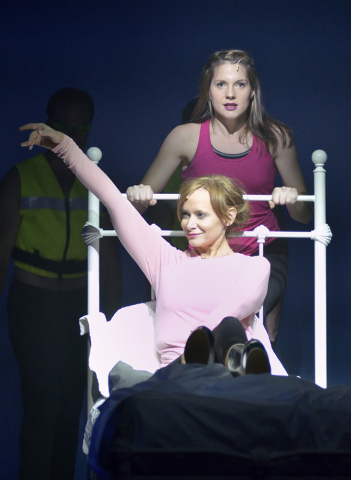"""Christine Sherrill, as Donna, in bed, and Kimbre Lancaster, as Sophie, perform during a technical rehearsal for """"Mamma Mia!"""" in the Tropicana Theater at the Tropicana hotel-casino at 380 ..."""