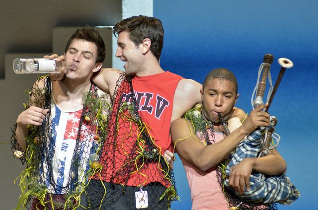 """Joe Moeller, as Pepper, left, Jordan Bondurant, as Sky, center, and James Tolbert, as Eddie, perform during a technical rehearsal for """"Mamma Mia!"""" in the Tropicana Theater at the Tropica ..."""
