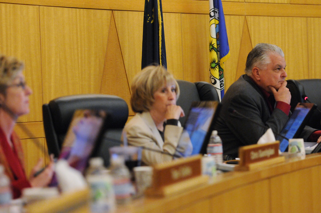 Clark County Commissioners Chris Giunchigliani, from left, Susan Brager and Steve Sisolak, listen to public comment during a meeting on a new ordinance that would allow medical marijuana dispensar ...