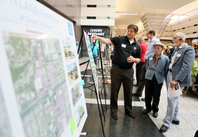 Raymond Hess, from left, manager of planning at Regional Transportation Commission, places a note on a map while having a discussion with Walt Herron and Terry Wilsey during a Southern Nevada Stro ...
