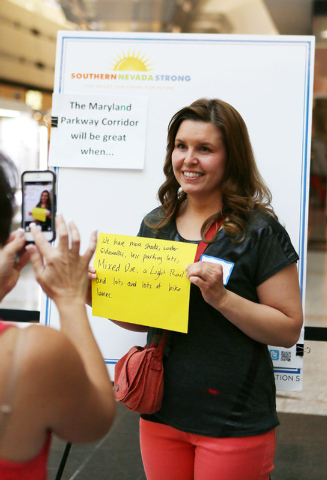 """Elena Howe has her photo taken for social media with her handwritten response to """"The Maryland Parkway Corridor will be great when..."""" during a Southern Nevada Strong regional planning i ..."""