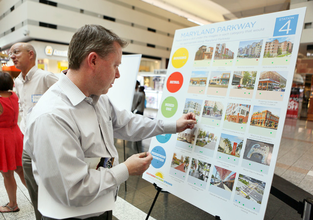 Pete McCann rates items on a board with stickers during a Southern Nevada Strong regional planning initiative open house at The Boulevard Mall Thursday, May 22, 2014, in Las Vegas. Community membe ...