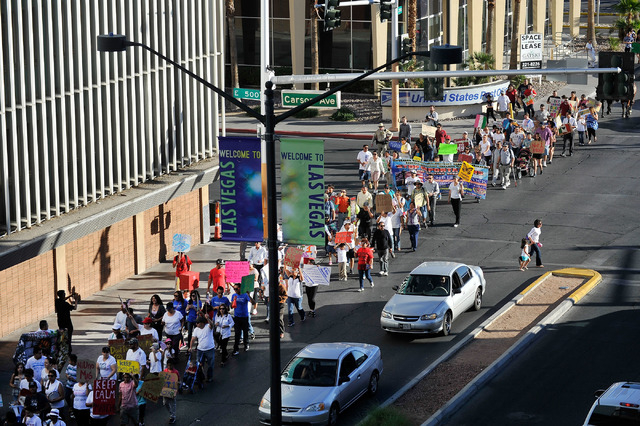 Protesters march during a May Day rally for immigration reform along Las Vegas Boulevard in downtown Las Vegas on Thursday, May 1, 2014.  About 200 people staged a rally at the U.S. Federal Courth ...