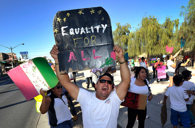 Jorge Perez demonstrates for for immigration reform during a May Day rally along Las Vegas Boulevard in downtown Las Vegas on Thursday, May 1, 2014.  About 200 people staged a rally at the U.S. Fe ...