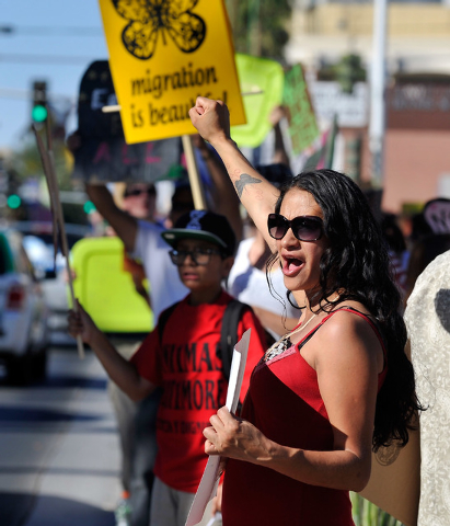 Brenda Cass demonstrates for for immigration reform during a May Day rally along Las Vegas Boulevard in downtown Las Vegas on Thursday, May 1, 2014.  About 200 people staged a rally at the U.S. Fe ...