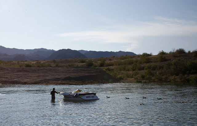 A boater prepares to take his boat out of the water at the boat landing dock by the Las Vegas Boat Harbor on Lake Mead near Boulder City. Thursday, Sept. 15, 2011. Visitation to the Lake Mead Nati ...