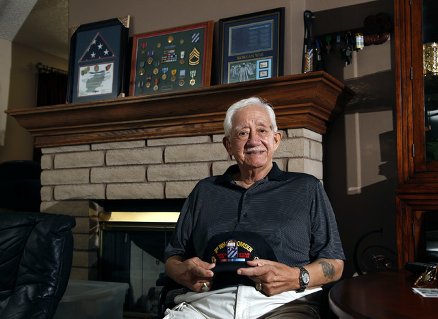 Korean War ex-POW Gene Ramos talks about what Memorial Day means to him during an interview at his home in Las Vegas on Thursday, May 22, 2014. He was captured as Chinese forces advanced from Chos ...