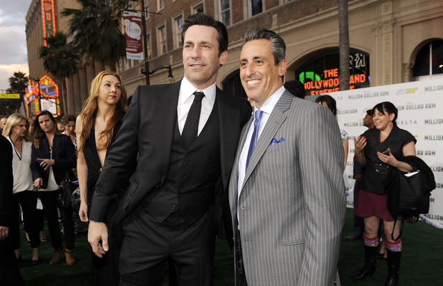 "Jon Hamm, left, and J.B. Bernstein arrive at the world premiere of ""Million Dollar Arm"" at El Capitan Theatre in Los Angeleson Tuesday, May 6, 2014. Bernstein's wife, Brenda, is at left. (Photo by ..."