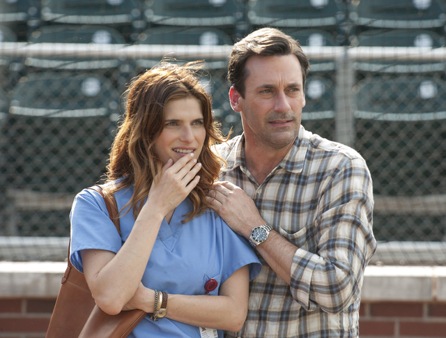 "Jon Hamm is J.B. Bernstein and Lake Bell iss Brenda, J.B.'s neighbor and friend, in Walt Disney Pictures' ""Million Dollar Arm,"" based on the true story of two young men who went from never throwin ..."