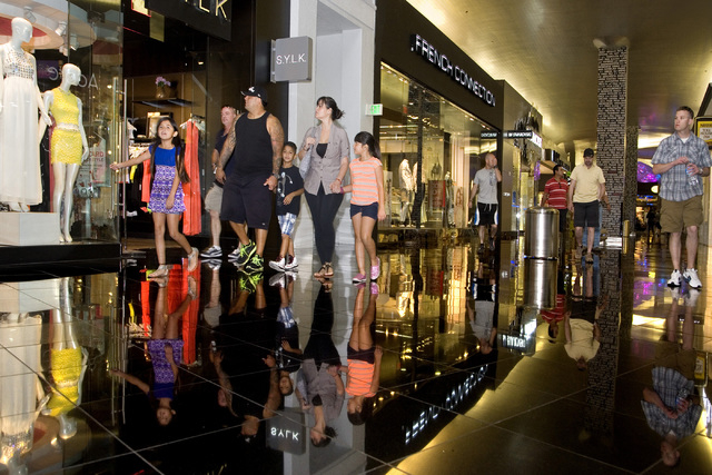 People walk through Miracle Mile Shops at Planet Hollywood in Las Vegas on Friday, May 9, 2014. General Manager Jerry Irwin said a 60,000 sq. ft. expansion of the mall is planned for 2015. (Jefers ...