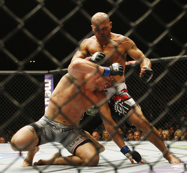 Robbie Lawler attacks Jake Ellenberger during UFC 173 at the MGM Grand Garden Arena in Las Vegas on Saturday, May 24, 2014. (Jason Bean/Las Vegas Review-Journal)