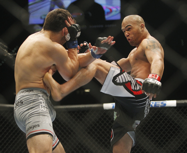 Robbie Lawler, right, kicks Jake Ellenberger during UFC 173 at the MGM Grand Garden Arena in Las Vegas on Saturday, May 24, 2014. (Jason Bean/Las Vegas Review-Journal)