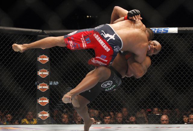 Daniel Cormier, right, takes down Dan Henderson during UFC 173 at the MGM Grand Garden Arena in Las Vegas on Saturday, May 24, 2014. (Jason Bean/Las Vegas Review-Journal)