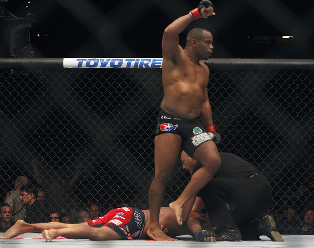Daniel Cormier celebrates after earning a submission against Dan Henderson during UFC 173 at the MGM Grand Garden Arena in Las Vegas on Saturday, May 24, 2014. (Jason Bean/Las Vegas Review-Journal)